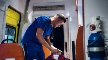 EMT Man Giving Oxygen to Patient